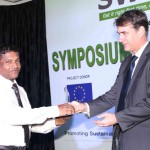 EDNA Chocolates Ceylon (Pvt.) Ltd plant manager accepting award