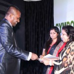 EDNA Cocoa Products (Pvt.) Ltd plant manager accepting award